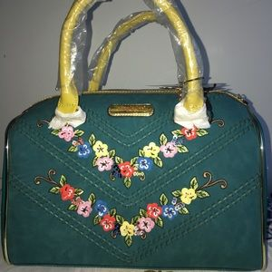 Just in green purse with flowers 💐
